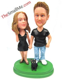 Couple with a small black dog